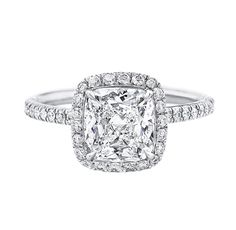 Harry Winston MicroPave..2.63 total carats...take this stone/design and place it on top of the Cartier Destinee band and we have a winner!!