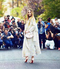 On Kristina Bazan:Chloé coat and dress; Christian Louboutin heels; Eugenia Kim crown.