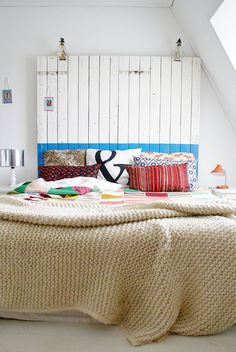 chambre à coucher by wood & wool stool, via Flickr  isn't that a pretty crochet/knit blanket ?