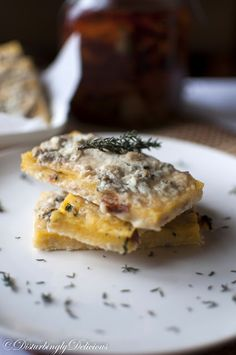 Crispy Polenta with Herbs, Sun-dried Tomatoes and Gorgonzola.  I'm madly in love with Gorgonzola lately.  It sounds divine on polenta ~kss