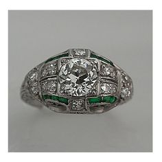 This is an Edwardian Old European Cut and Emerald Diamond Engagement Ring 0.80 Carats!