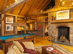 Rustic farmhouse man cave family room with wood burn fireplace and convertible pool table