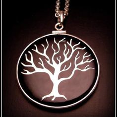 Hand cut sterling silver tree inlaid into resin and a silver frame. #norwoodsofnashville #nashville #pendant