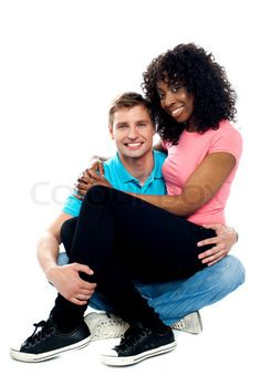 Stock image of 'African teenager sitting on boyfriends lap'