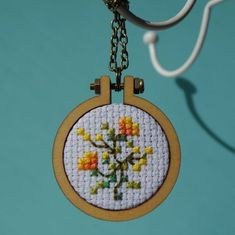 Orange Blossom Cross Stitch Necklace by CuteCosyCrafts on Etsy