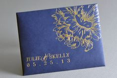 Haute Papier gold foil stamped envelope housing a wedding program #navy #gold  Read More: http://www.stylemepretty.com/little-black-book-blog/2013/12/27/greenville-country-club-wedding/