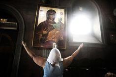 One woman prays inside the church.