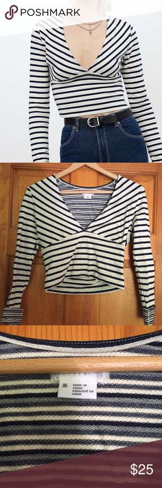 Urban Outfitters v-neck top Cute striped top with deep v-neck. Only worn twice. Runs small Urban Outfitters Tops