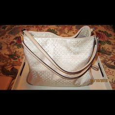 Coach Bag in Blush Color Coach bag in light pink color,, has 2 large outside compartments and in the middle has a hidden zipped compartment, has only been used once. It is in perfect condition.comes with dust bag. Coach Bags Totes