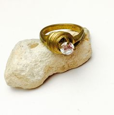 A personal favorite from my Etsy shop https://www.etsy.com/listing/240084061/solitaire-ring-size-9-brass-tone-vintage