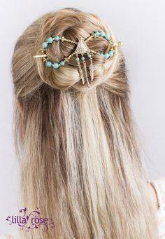 Long hair half up bun held by 'Chenoa', a flexi clip with turquoise and feathers for a unique southwestern flair!