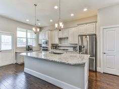 JUST REDUCED!     MLS #: 71111666     26922 Raven Hill Ln. Katy, TX 77494     Beautiful, like-new David Weekly Lainston floorplan. Energy Star Certified Home with Infrared Thermo-graphic Certification - which means a very, very low cost of ownership. Top of the line granite in the kitchen; upgraded wood floors in all areas except the bedrooms; Heatilator Fireplace; Lennox Elite Series A/C System; Gas Downdraft Cook top; Convection Oven; Stainless Steel Dishwasher and upgraded dual sinks.
