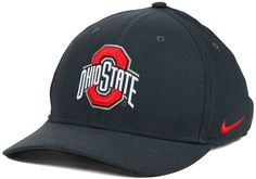 Use this Nike NCAA Classic Swoosh cap to show your support for the Ohio State Buckeyes, be it for their academia or the sports teams they field. Great for daily wear, this cap is comfortable and stylish all year long. Mid crown Structured fit Normal bill Embroidered team logo at front Stitched Nike swoosh logo at left side Embroidered team logo at back Stretch fitted Rayon/nylon/cotton/polyester Spot clean only