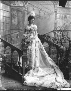 Exquisite Wedding Dresses of the 1800s (7/14) By the end of the century, brides were all trying to take things one step further than everyone else.  This 1898 photo of the Baroness Christine von Linden on her wedding day tells the story:  flowers everywhere, long train, gloves, high veil, etc.  She must have been quite striking in person!