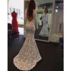Backless wedding dress by Berta
