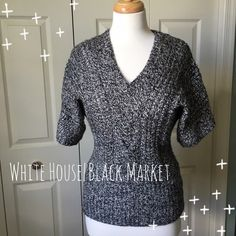 "Black & White Slouchy Sweater Gorgeous black and white cable-knit short sleeve slouchy sweater by White House Black Market.  ▪️25"" long ▪️V-neck style ▪️In great condition  🚭 Smoke-free home 📬 Ships by next day 💲 Price negotiable  🔁 Open to trades  💟Happy Poshing!💟 White House Black Market Sweaters V-Necks"