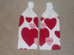 Two kitchen towels: Heart themed towels with hand crocheted white yarn toppers. Both towels are brand new and made of 100% cotton terry