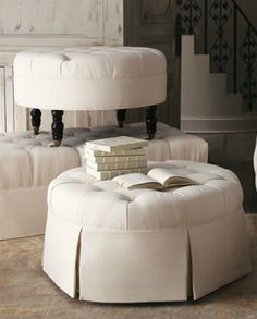 I LOVE ottomans. They are great for putting your feet up, for additional seating, and if you place a tray on top they can also be used as coffee tables!