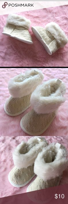 Cable knit cream sparkly boots NWOT Cream/white crib boots. Cable knit with a silver sparkle throughout. Faux fur trim. 0-3 months. NWOT never worn.  ✨offers considered! 📦 bundle to save! Carter's Shoes Baby & Walker