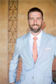 groom in pinstriped suit and coral tie #groomlooks #malibuwedding #weddingchicks http://www.weddingchicks.com/2014/01/06/coast-to-coast-wedding/