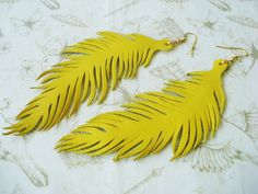 leather feather earrings!
