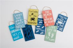Small Wooden Colourful Beach Signs. Design 1: Live Life In Flip Flops Design 2: Let your Dreams Set sail