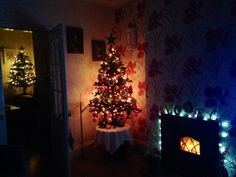 #christmas in #england two #christmastrees #redandgold #whiteandsilver #xmas
