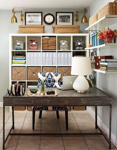 IKEA Expedit Bookcase...symmetry.  Floating shelves.  White on gray.  Natural finish desk.  Brass fixtures.  Has an ocean vibe.