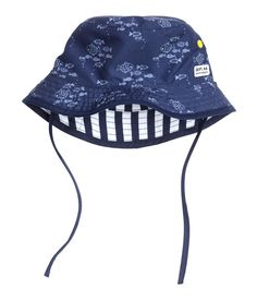Check this out! Reversible sun hat with a printed pattern and narrow ties. - Visit hm.com to see more.