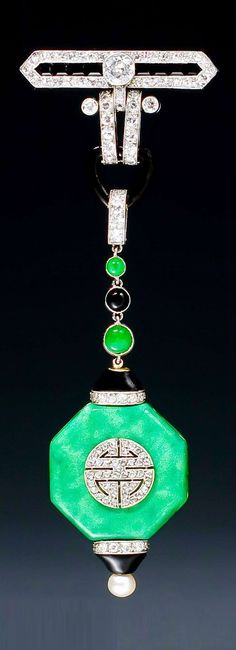 Van Cleef & Arpels - An Art Deco onyx, jade, enamel and diamond lapel watch, mounted in platinum and 18 karat gold, Paris, circa 1924. Signed VAN CLEEF ARPELS and numbered Hall marks: Maker's mark of Rubel Frères and French assay marks for platinum. 8.8 x 3.2cm. #VanCleefArpels #ArtDeco #LapelWatch