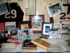 Ideas for memorabilia table at a reunion..jerseys, scrapbooks, pictures, pom poms, newspapers!
