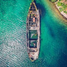 """Gargantua... In 1952 the damaged and partially sunken """"Gargantua"""" steamer tug limped into the calm waters of this bay for repairs. After getting stuck in the shallow waters a fire dealt the final blow. Shot from the #Drone while exploring the Bruce Peninsula.  Captured by @justensoule . . . . #drones #dji #dronegear #dronestagram #droneoftheday #dronefly #aerialphotography #dronesdaily #quadcopter #phantom4 #dronephotography #inspire1 #dronephoto #dronelife #phantom3 #fromwhereidrone…"""