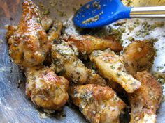 Garlic Parmesan Wings                   1 pound chicken wings 1 tsp oregano 1 tsp rosemary 1 tsp salt 1/2 tsp cumin 2 Tbsp. olive oil 1 Tbsp basil 1 Tbsp chopped garlic 1/4 cup Parmesan cheese, grated -  whisk together oregano, rosemary, cumin and salt. Add chicken wings, toss to coat, bake @ 425 for 25-30 minutes, whisk together olive oil, basil, chopped garlic and Parmesan cheese. Add cooked wings and toss well to coat, serve