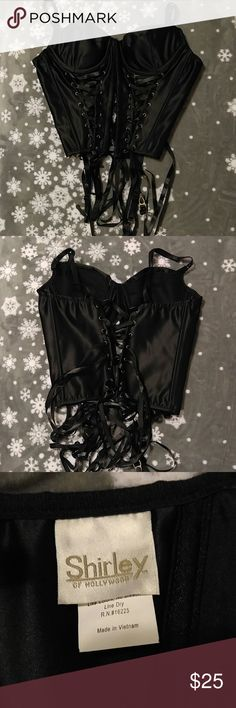 Corset Style Bustier NEVER Worn. Perfect Condition. Adjustable Straps. Padded Cups. Attached Garter Belt Clips. Front EyeHook Closure with Lace-up detail under each cup. Ribbon Back Closure. Likable Boning. No Stains or Flaws. Shirley of Hollywood. Intimates & Sleepwear Shapewear
