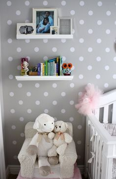 Beautifully styled nursery reading corner. Polka dot print on the gray-painted wall.