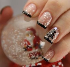 Snow inspired French manicure. Tip your nails in thin black lines over a clear base coating. On top of it add various sized white dots as if to represent the falling snow on a winter's day.