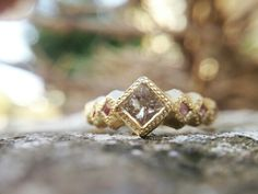 18k gold ring set with princss shampain diamind and pink sappairs You can find me in my facebook at Mann Jewellery