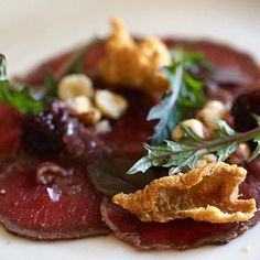Ever dreamt of your own country estate? This is just one of the tantalising courses at Linden Tree restaurant @lindenderry Red Hill on #Victoria's remarkable #MorningtonPeninsula. #Delicious Venison Carpaccio with preserved blackberries toasted hazelnuts bulls blood leaf Lindenderry Pinot Noir Sauce & a little pork crackle. Award-winning Executive Chef Michael Greenlaw & his team work magic like this daily. (click the link in the bio for more on Lindenderry). #mylindenderryindulgence…