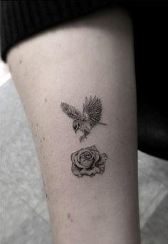 Bird landing on rose tattoo | | By Dr. Woo