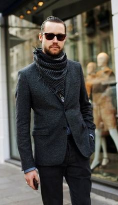 Shop this look on Lookastic:  https://lookastic.com/men/looks/blazer-dress-shirt-jeans/13893  — Dark Brown Sunglasses  — Charcoal Vertical Striped Scarf  — Charcoal Wool Blazer  — Blue Dress Shirt  — Black Jeans