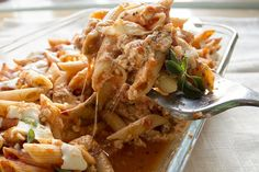 skinny 3 cheese penne recipe serves 8 low fat low calorie low sodium and vegetarian view of a single serving spoon view of inside of the casserole