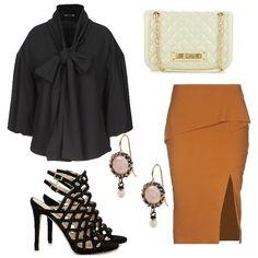 28eafcdb054a Bellissima blusa nera con ampio fiocco. Da indossare dentro