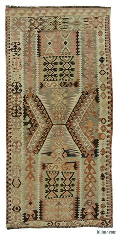 Vintage Turkish tribal kilim rug handwoven in 1960's in the Mut region of the Taurus Mountains by the Taurus Yoruks who are migratory people of Central Asian origin. This piece is in very good condition.