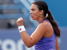 Marion Bartoli of France reacts during a match with Laura Robson of Great Britain at the Connecticut Tennis Center at Yale on August 19, 2012 in New Haven, Connecticut.