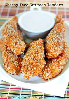 Cheesy Taco Chicken Tenders: Crunchy, baked chicken tenders coated in taco-spiced cheddar panko crumbs with a homemade ranch dressing for dipping.