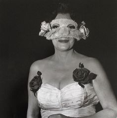 Diane Arbus, photo |1923-1971, USA | Lady at a Masked Ball with Two Roses on Her Dress, NYC, 1967