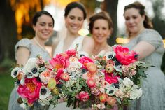 close up of vibrant and colorful wedding bouquets of coral charm peony, white anemone, peach stock, peach juliet garden rose, peach ranunculus, pink ranunculus, thistle, white majolik spray rose, lamb's ear dusty miller scabiosa pods and seeded eucalyptus.
