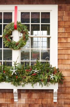 Cedar siding, white trim, and plentiful windowboxes are the stuff of dreams, especially around the holidays. Here, traditional holiday wreaths and greenery deck the windows.   Coastalliving.com