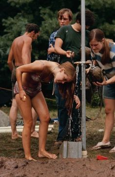 "Caption from LIFE. ""For a while, washing made sense. Then the mud got too deep."" Woodstock 1969"