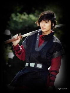 Lee Min Ho in red crescent uniform with katana.